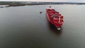 Aerial View of Container Ship and Tugboat Arriving Port Philadelphia. Aerial View of Container Ship and Tugboat Arriving Port of Philadelphia stock footage