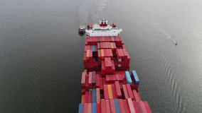 Aerial View of Container Ship and Tugboat Arriving Port Philadelphia. Aerial View of Container Ship and Tugboat Arriving Port of Philadelphia stock video