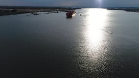 Aerial View of Container Ship and Tugboat Arriving Port Philadelphia. Aerial View of Container Ship and Tugboat Arriving Port of Philadelphia stock video footage