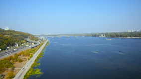 Aerial view from copter Bridge through the Dnipro river in Kiev. Ukraine stock footage