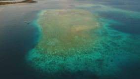 Coral Reef Atoll, Bali. Aerial view coral reef, atoll with turquoise water in the sea.Tropical atoll, coral reef in ocean waters. 4K video. Travel concept stock video footage