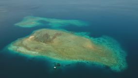 Coral Reef Atoll, Bali. Aerial view coral reef, atoll with turquoise water in the sea.Tropical atoll, coral reef in ocean waters. 4K video. Travel concept stock video