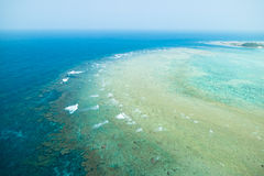 Aerial view of coral reef with clear blue tropical water Royalty Free Stock Photos