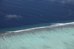 Aerial view of coral reef in Maldives. Focus on the reef Stock Image