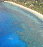 Aerial view of coral reef and tropical beach Stock Photos