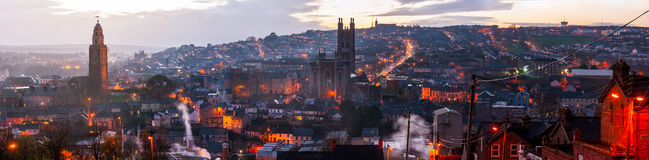Aerial view of Cork, Ireland at sunset. Aerial view of St. Anne's Church and Cathedral in Shandon, Cork, Ireland. Mountains and sunset cloudy sky Royalty Free Stock Photo