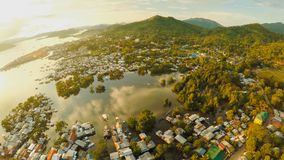 Aerial view Coron city with slums and poor district. Palawan. Bu. Suanga island. Evening time and sunset. Fisheye view Stock Images