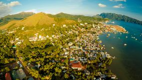 Aerial view Coron city with slums and poor district. Palawan. Bu. Suanga island. Evening time and sunset. Fisheye view Royalty Free Stock Images