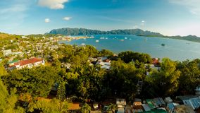 Aerial view Coron city with slums and poor district. Palawan. Bu. Suanga island. Evening time and sunset. Fisheye view Stock Photos