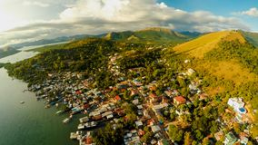 Aerial view Coron city with slums and poor district. Palawan. Bu. Suanga island. Evening time and sunset. Fisheye view Royalty Free Stock Photos
