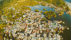 Aerial view Coron city with slums and poor district. Palawan. Bu. Suanga island. Evening time and sunset. Fisheye view Stock Photography