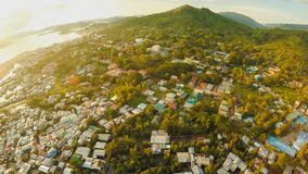 Aerial view Coron city with slums and poor district. Palawan. Bu. Suanga island. Evening time and sunset. Fisheye view Stock Image