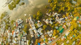Aerial view Coron city with slums and poor district. Palawan. Bu. Suanga island. Evening time and sunset Royalty Free Stock Photo