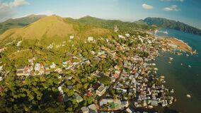 Aerial view Coron city with slums and poor district. Palawan. Busuanga island. Evening time and sunset. Fisheye view. Aerial view Coron city with slums and poor stock footage