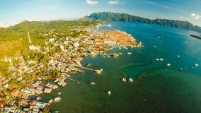 Aerial view Coron city with slums and poor district. Palawan. Bu. Suanga island. Evening time and sunset. Fisheye view Royalty Free Stock Photography