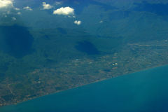 Aerial view on cost. Blue water and city Stock Image