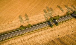 Aerial view of a country road amid fields. With a car on it Stock Photography
