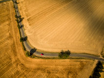 Aerial view of a country road amid fields Royalty Free Stock Photos