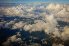 Aerial view of country side. Aerial top view of suburban district through the clouds Royalty Free Stock Photo