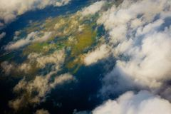 Aerial view of country side. Aerial top view of suburban district through the clouds Stock Photo