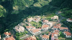 Aerial View of the Countryside in Mountains. Aerial View of the Typical Town in Mountains, Madeira Portugal stock footage