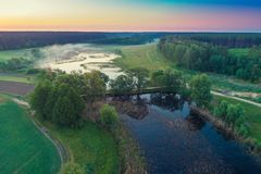Aerial view of countryside and river. Early morning, wilderness. Aerial view of countryside and river stock photography