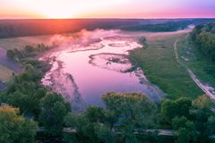 Aerial view of countryside and river. Early morning, wilderness. Aerial view of countryside and river at sunrise stock photo