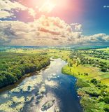 Aerial view of the countryside and river in evening. Aerial view of countryside and river in evening.  Sunset over the river stock photo
