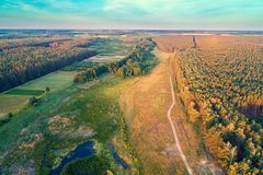 Aerial view of countryside and river in the forest. In evening. Sunset over the river royalty free stock photo