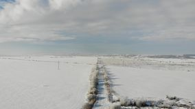 Aerial view of countryside, winter landscape. Smooth fly back stock video