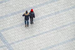 Aerial view of couple crossing the square in the city of Munich royalty free stock images