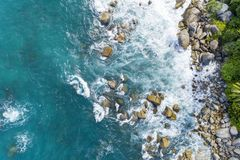 Aerial view of crashing waves on rocks landscape nature view and Beautiful tropical sea with Sea coast view in summer season image stock image