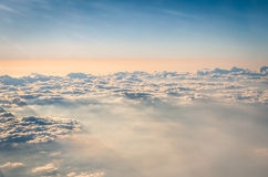 Aerial view of crispy clouds and sky from an airplane Royalty Free Stock Image