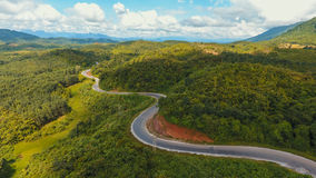 Aerial view of crooked path of road on the mountain. Royalty Free Stock Photo