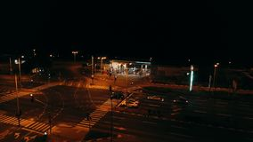 Crossroad with gas station night low city traffic. 4K aerial video. Aerial view of crossroad with gas station night low city traffic. 4K video stock video