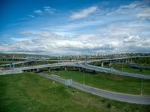 Aerial view of crossroads under clouds royalty free stock photography