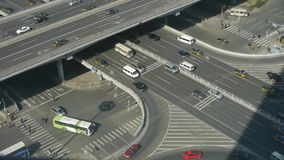 Aerial view of crosswalk & overpass traffic at an urban city beijing China. This is Aerial view of crosswalk & overpass traffic at an urban city beijing stock footage