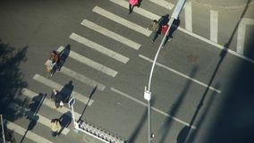 Aerial view of crosswalk & traffic at an urban city,zebra crossing. This is Aerial view of crosswalk & traffic at an urban city,zebra crossing stock video footage