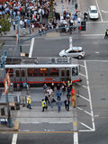 Aerial view of crowd of people crossing street to get to ballpar. SAN FRANCISCO, CA - SEPTEMBER 28: Aerial view of crowd of people crossing street to get to Stock Images