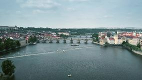 Aerial view of crowded famous Charles Bridge in Prague and Vltava riverbanks, the Czech Republic stock video