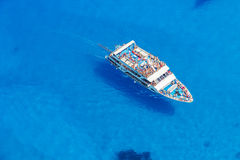 Aerial view of cruise boat in azure sea Stock Photo