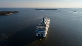 Aerial view of cruise liner sailing in the open sea at sunset stock photo