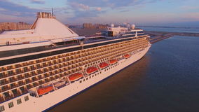 Aerial view of the Cruise Ship in Harbor at Sunset. Aerial view of the Beautiful cruise liner is in port of St. Petersburg at sunset. He is white, with a stock footage