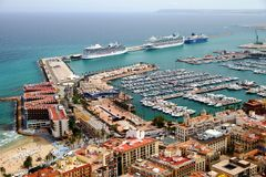 Aerial view of cruises docked in the port of Alicante. Port of Alicante with cruiseships docked in a landscape viewed from the towers of Santa Barbara Castle in Royalty Free Stock Photography