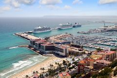 Aerial view of cruises docked in the port of Alicante. Port of Alicante with cruiseships docked in a landscape viewed from the towers of Santa Barbara Castle in Stock Photography