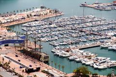 Aerial view of cruises docked in the port of Alicante. Port of Alicante with cruiseships docked in a landscape viewed from the towers of Santa Barbara Castle in Royalty Free Stock Image