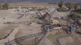 Aerial view of crushed stone quarry machine. Original LOG. Crushed stone quarry machine at sunset view from above. Original untouched LOG format stock video