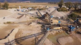 Aerial view of crushed stone quarry machine. Crushed stone quarry machine at sunset view from above stock video
