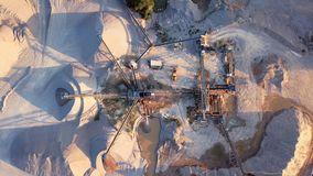 Aerial view of crushed stone quarry machine. Crushed stone quarry machine at sunset view from above stock footage