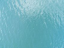 Aerial view of a Crystal clear sea water texture. View from above Natural blue background. Turquoise ripple water reflection in tr. Opical beach. Blue ocean wave stock photos